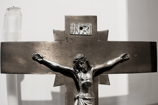 a silver toned picture of the crucifix